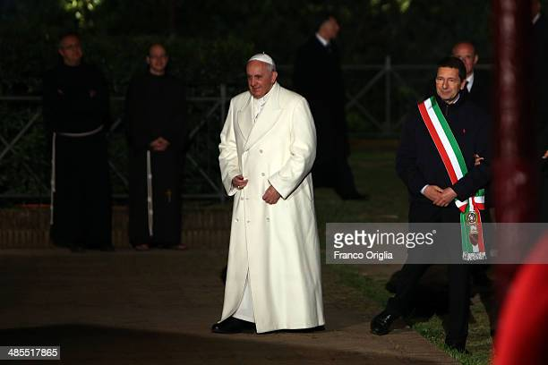 Pope Francis and Mayor of Rome Ignazio Marino attend the Way of The Cross at the Colosseum on April 18 2014 in Rome Italy The Way of the Cross is a...