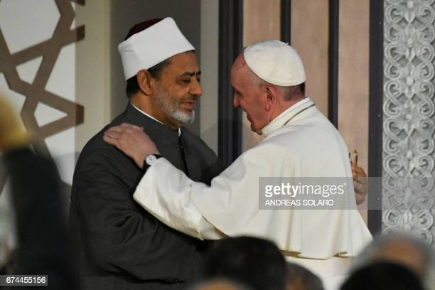 Pope Francis and Sheikh Ahmed alTayeb the Grand Imam of AlAzhar embrace during a visit of the Pope to the prestigious Sunni institution in Cairo on...