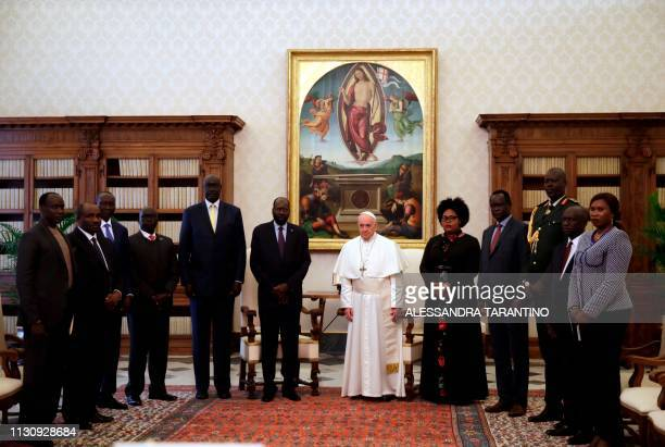 Pope Francis and South Sudan's President Salva Kiir Mayardit pose with members of the South Sudanese delegation at the end of a private audience at...