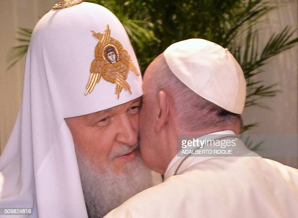 Pope Francis and the head of the Russian Orthodox Church Patriarch Kirill kiss each other during a historic meeting in Havana on February 12 2016...