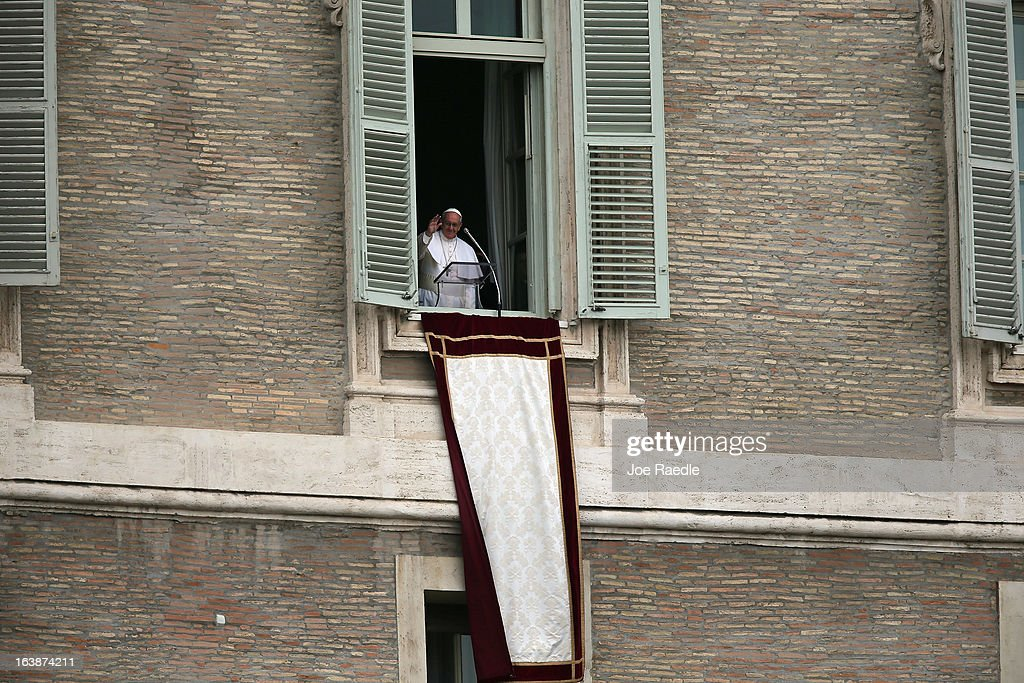 Pope Francis appears in the window of his apartment to recite the Angelus prayer on March 17, 2013 in Vatican City, Vatican. The Vatican is preparing for the inauguration mass of Pope Francis, the first ever Latin American Pontiff on March 19.