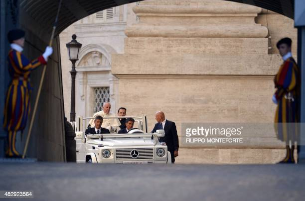 Pope Francis arrives aboard his Popemobile for an audience with participants of an international pilgrimage of altar servers on August 4 2015 in...