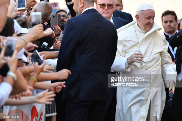 Pope Francis arrives after his mass at the 'Rotonda' on the Lungomare of Bari to meet with other religious leaders at the Pontifical Basilica of St...