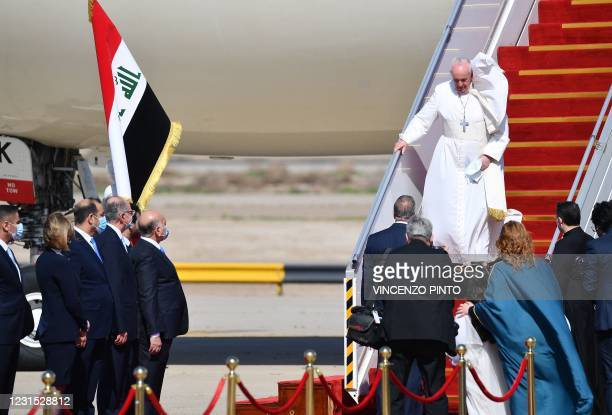 Pope Francis arrives at Baghdad airprot on March 5, 2021 on the first papal visit to Iraq. - Pope Francis began his historic trip to war-scarred...