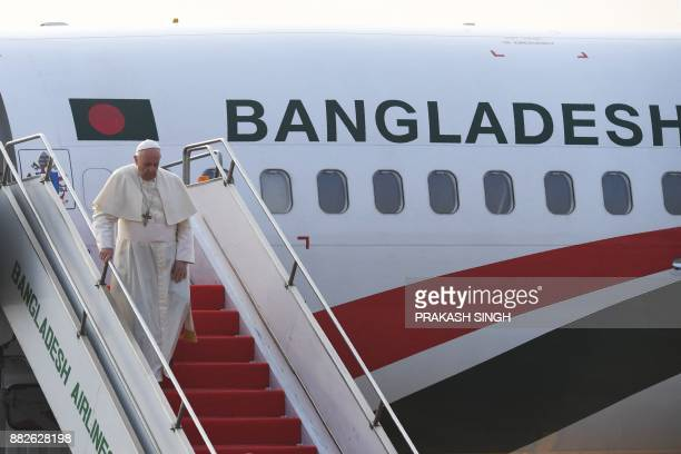 Pope Francis arrives at the airport in the Bangladeshi capital Dhaka on November 30 2017 Pope Francis arrived in Bangladesh from Myanmar on November...