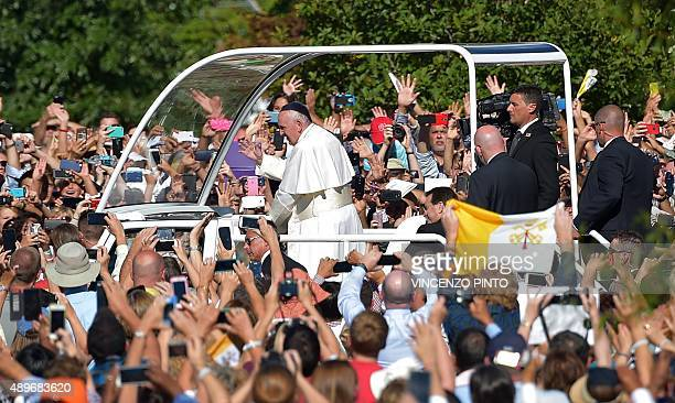 Pope Francis arrives at the Basilica of the National Shrine of the Immaculate Conception in Washington DC on September 23 2015 AFP PHOTO / VINCENZO...