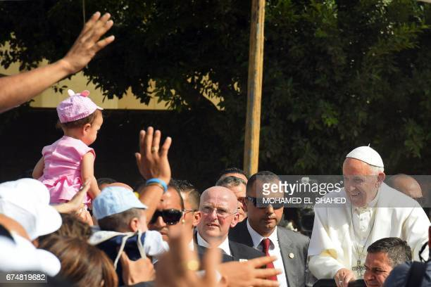 Pope Francis arrives at the Coptic Catholic College of Theology and Humanities in the southern Cairo suburb of Maadi on April 29 2017 Pope Francis...
