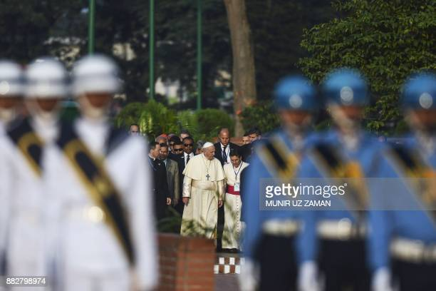 Pope Francis arrives at the National Martyrs' Memorial of Bangladesh at Savar some 30 km from Dhaka on November 30 2017 Pope Francis arrived in...