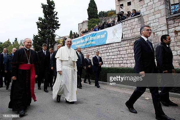 Pope Francis arrives at the sports camp of the Serafico Institute on October 4 2013 near Assisi Pope Francis visits Assisi for the first time today...
