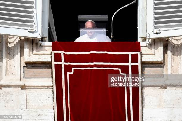 Pope Francis arrives at the window of the Apostolic Palace overlooking St Peter's square to deliver his weekly Angelus prayer on February 10 2019 at...