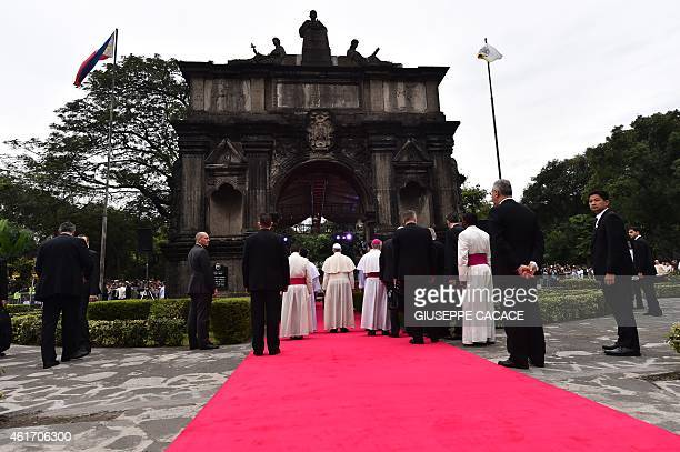 Pope Francis arrives for a visit to the University of Santo Tomas in Manila on January 18 2015 Pope Francis later celebrated mass with millions of...