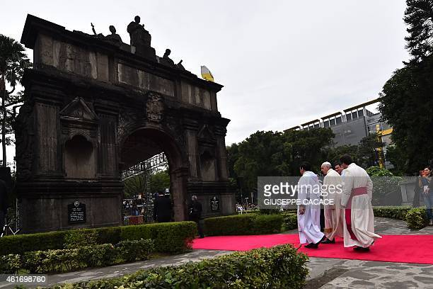 Pope Francis arrives for his visit to the University of Santo Tomas in Manila on January 18 2015 Pope Francis will celebrate mass with millions in...