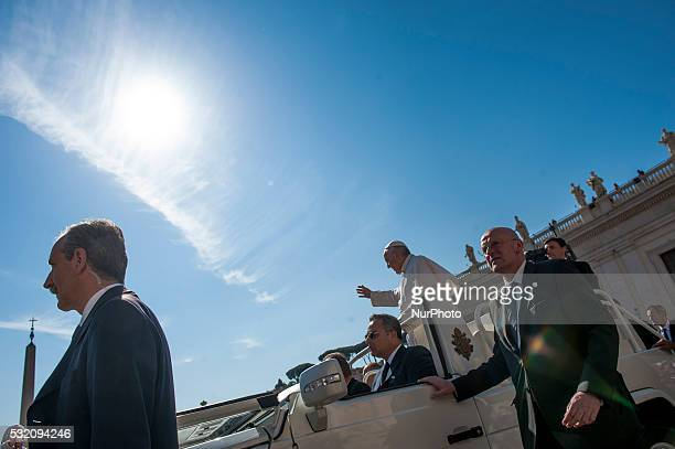 Pope Francis arrives for his weekly general audience in St Peter's Square at the Vatican Wednesday May 18 2016