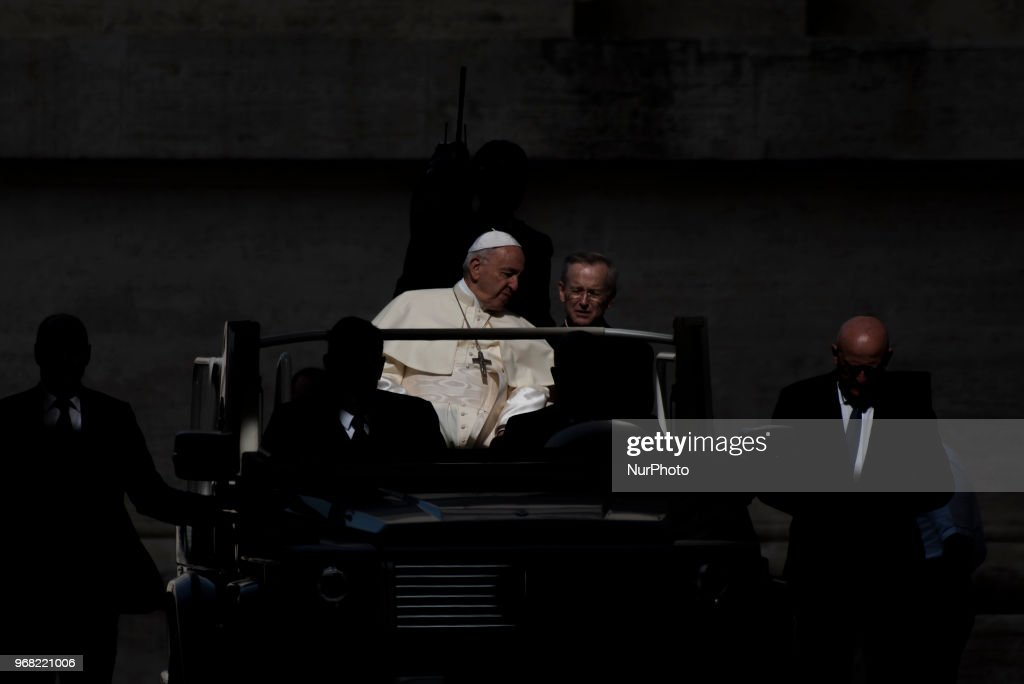 Pope Francis arrives for his weekly general audience in St. Peter's Square at the Vatican, 6 June 2018.