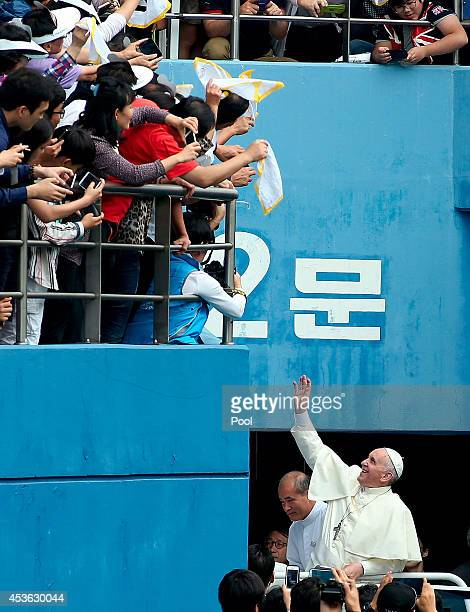 Pope Francis arrives for the Mass of Assumption of Mary at World Cup soccer stadium on August 15, 2014 in Daejeon, South Korea. Pope Francis is...