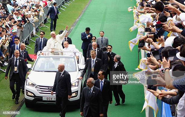 Pope Francis arrives for the Mass of Assumption of Mary at World Cup soccer stadium on August 15 2014 in Daejeon South Korea Pope Francis is visiting...