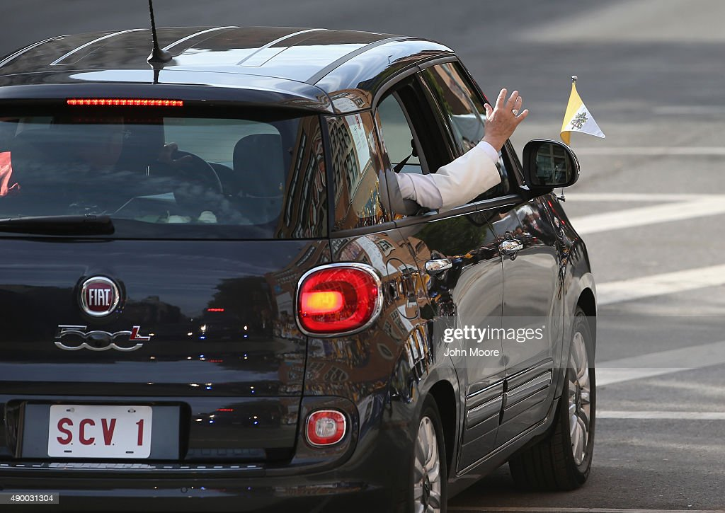 Pope Francis arrives in his Fiat to the Lady Queen of Angels school on September 25, 2015 in the Harlem neighborhood of New York City. The Pope visited the inner city Catholic school in east Harlem and met with children, immigrants and Catholic Charities workers on the second day of his visit to New York City.