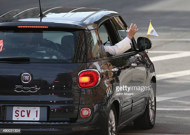 Pope Francis arrives in his Fiat to the Lady Queen of Angels school on September 25 2015 in the Harlem neighborhood of New York City The Pope visited...