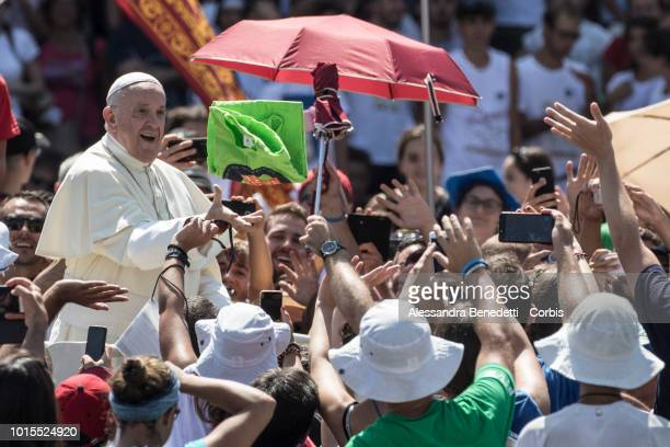 Pope Francis arrives in St Peters Square to attend a meeting with Italian young People and to deliver his Angelus Prayer at The Vatican on August 12...