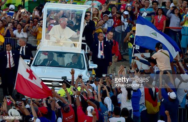 Pope Francis arrives in the popemobile to preside over an evening vigil with young people at the Campo San Juan Pablo II in Panama City, on January...