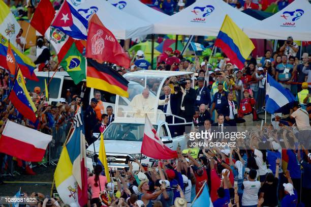 Pope Francis arrives in the popemobile to preside over an evening vigil with young people at the Campo San Juan Pablo II in Panama City on January 26...