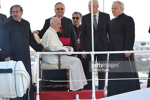 Pope Francis arrives in the port of the island on board of a Guardia Costiera boat on July 8 2013 in Lampedusa Italy On his first official trip...