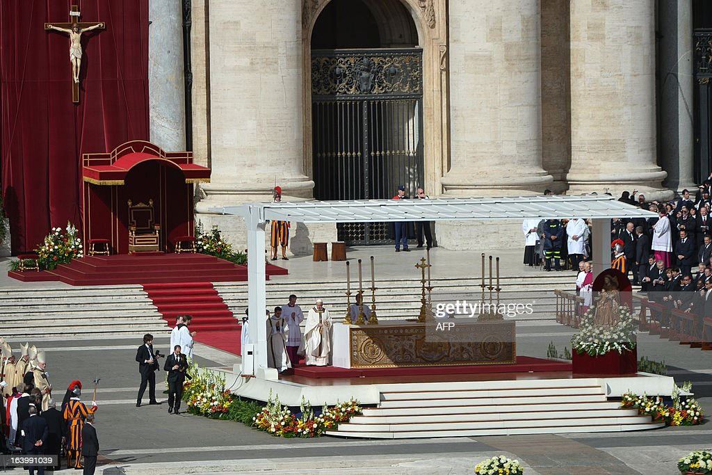 Pope Francis (C) arrives on the altar for his grandiose inauguration mass on March 19, 2013 at the Vatican. Pope Francis swept into St Peter's Square on Tuesday to greet throngs of pilgrims before a sumptuous ceremony in which Latin America's first pontiff will receive the formal symbols of papal power.