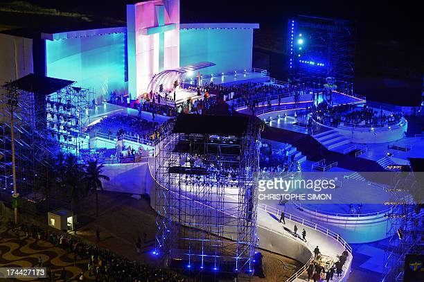 Pope Francis arrives on the popemobile at a stage mounted in Rio de Janeiro's iconic Copacabana beachfront on July 25 2013 for his welcome to World...