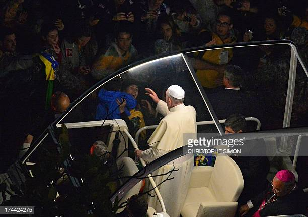 Pope Francis arrives on the popemobile at Rio de Janeiro's iconic Copacabana beachfront on July 25 2013 for his welcome to World Youth Day ceremonies...