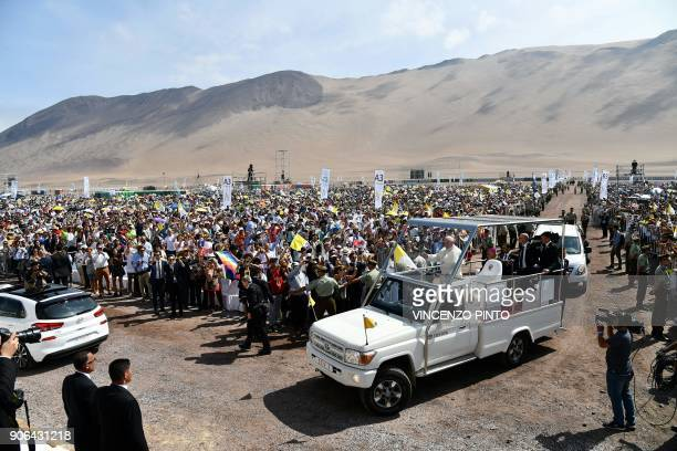 Pope Francis arrives on the popemobile at the site at Lobitos Beach, near the northern Chilean city of Iquique, where he will celebrate an open-air...