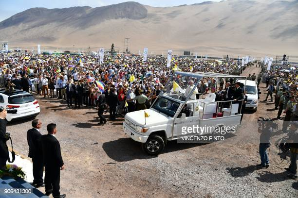 Pope Francis arrives on the popemobile at the site at Lobitos Beach near the northern Chilean city of Iquique where he will celebrate an openair mass...