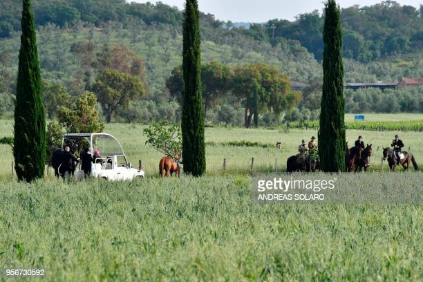 Pope Francis arrives on the popemobile for a pastoral visit in Nomadelfia on May 10 2018 near Grosseto Tuscany