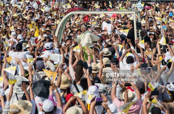 Pope Francis arrives on the popemobile to celebrate mass at the Las Palmas air base in Lima on January 21 2018 Pope Francis was preparing to wrap up...