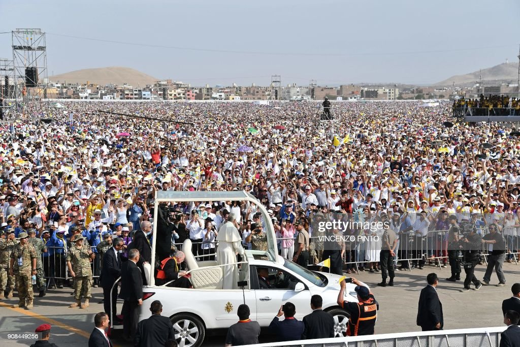Pope Francis arrives on the popemobile to celebrate mass at the Las Palmas air base in Lima on January 21, 2018. Pope Francis was preparing to wrap up his Latin American trip on Sunday with a mass at the air base where a million faithful were expected to hear him speak. On the last day of a week-long trip that has taken him to six cities in Chile and Peru, the 81-year-old pontiff began the day by delivering a homily to 500 nuns, as well as meeting the bishops of Peru. PHOTO / Vincenzo PINTO