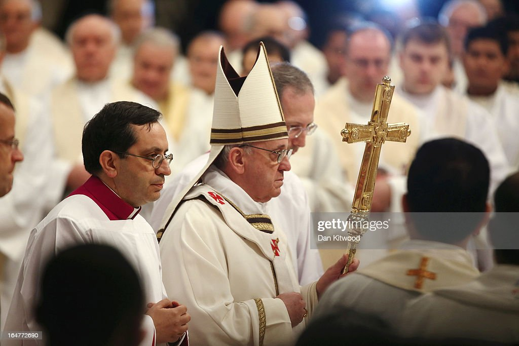 Pope Francis arrives to conduct his first Chrism Mass inside St Peter's Basilica on the morning of Holy Thursday on March 28, 2013 in Vatican City, Vatican. Pope Francis is currently taking part in his first holy week as pontiff. The pope's first holy week will also incorporate him washing the feet of prisoners in a youth detention centre later today.