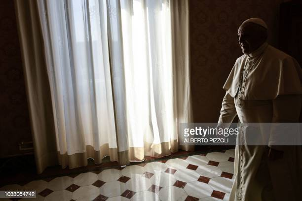 TOPSHOT Pope Francis arrives to greet the President of Mozambique upon his arrival for their meeting on September 14 2018 at the Vatican Mozambican...