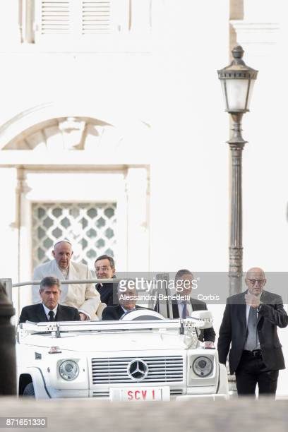 Pope Francis arrives to lead his general weekly audience on November 8 2017 in Vatican City Vatican