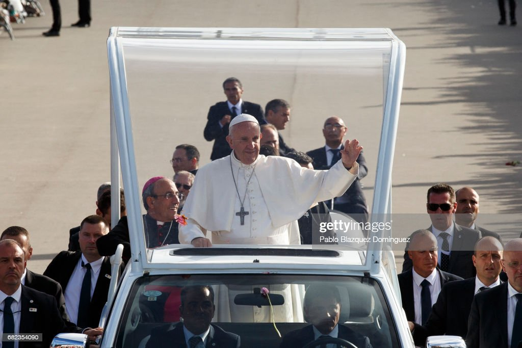Pope Francis arrives to the Sanctuary of Fatima on May 12, 2017 in Fatima, Portugal. Pope Francis will be attending the Sanctuary of Fatima, in Portugal, on May 12 and 13 to canonize two Portuguese shepherds, Jacinta and Francisco Marto, who are said to have witnessed the apparition of what they believed was the Virgin Mary, together with their aunt Lucia Santos, 100 years ago. Thousands of pilgrims and worshippers from around the world are expected to gather at the centenary celebration.