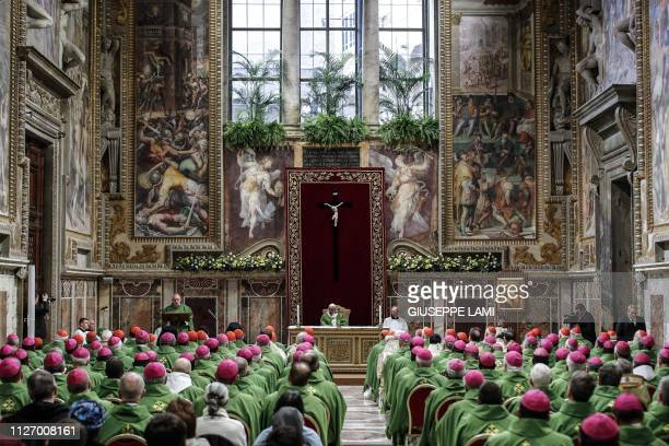 TOPSHOT Pope Francis attends a Eucharistic celebration at the Regia Hall of the Apostolic Palace in the Vatican on February 24 within the fourth and...