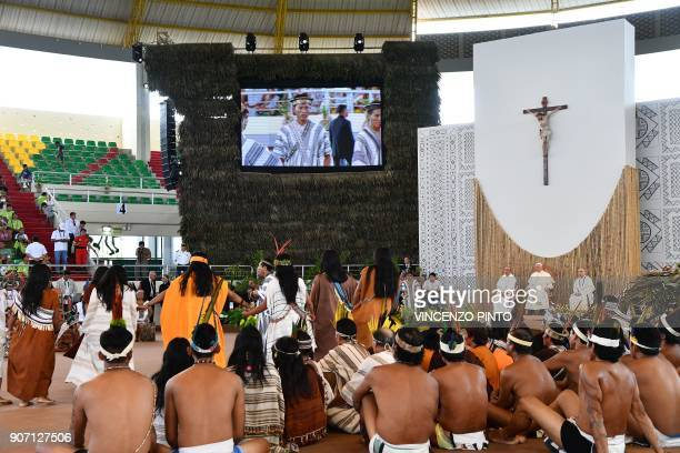 Pope Francis attends a meeting with representatives of indigenous communities of the Amazon basin from Peru Brazil and Bolivia in the Peruvian city...