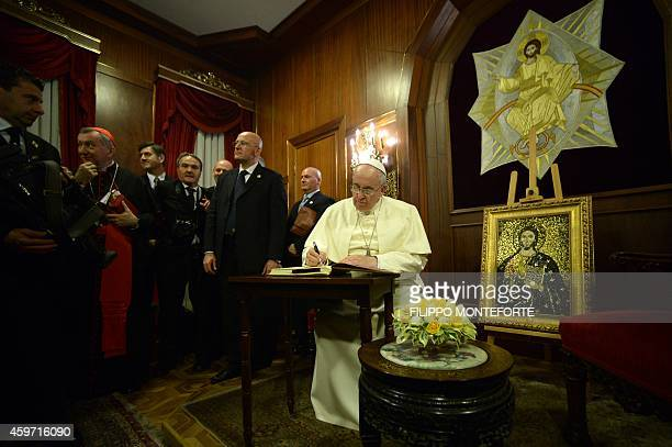 Pope Francis attends a meeting with the Ecumenical Patriarch Bartholomew I of Constantinople at the St George church the principal Greek Orthodox...