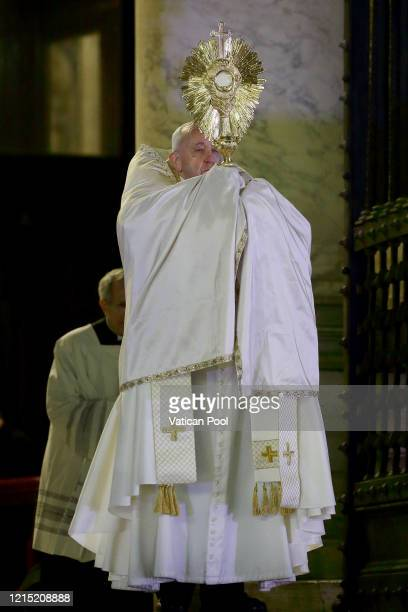 Pope Francis attends an extraordinary moment of prayer in time of pandemic the adoration of the Blessed Sacrament and delivers an extraordinary Urbi...