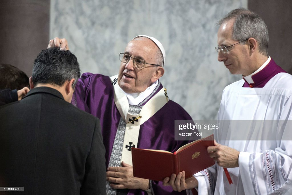 Pope Francis attends Ash Wednesday at the Santa Sabina Basilica on February 14, 2018 in Rome, Italy. Pope Francis celebrated Ash Wednesday Mass in the Basilica of Santa Sabina in Rome. As per tradition the ceremony started at the Basilica of St. Anselm where the Pope led a penitential procession to the nearby St. Sabina, marking the beginning Lent, the time of preparation for Holy Week.