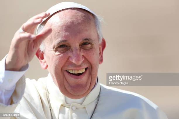 Pope Francis attends his weekly General Audience in St Peter's Square on September 18 2013 in Vatican City Vatican Pontiff called on Catholics...