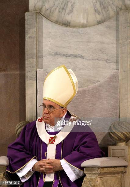 Pope Francis attends in the Santa Sabina church in Rome on March 5 the Ash Wednesday mass opening Lent the fortyday period of abstinence and...