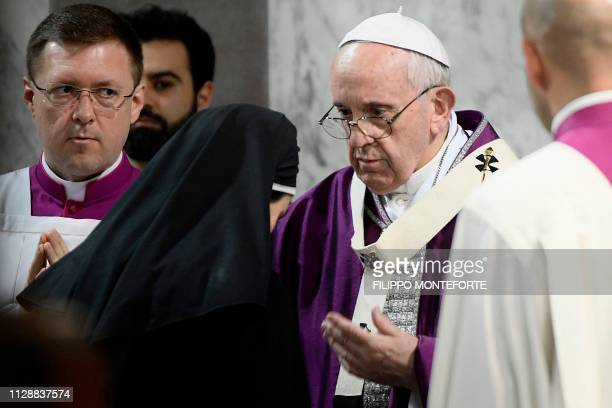 Pope Francis blesses a nun during the Ash Wednesday mass which opens Lent the fortyday period of abstinence and deprivation for Christians before...