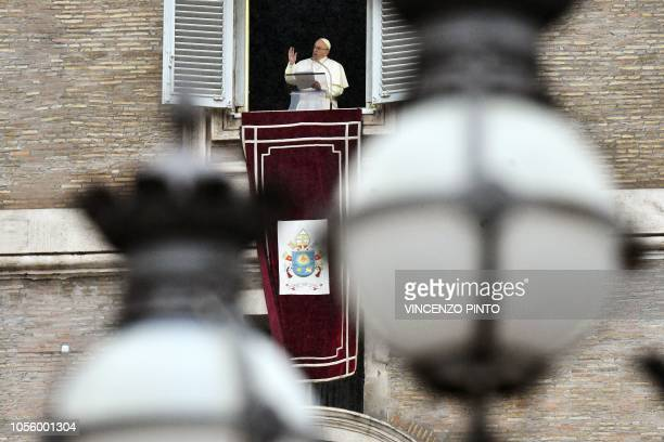 Pope Francis blesses pilgrims gathered in St Peter's Square at The Vatican on November 1 after his Angelus prayer to mark the All Saint festivities