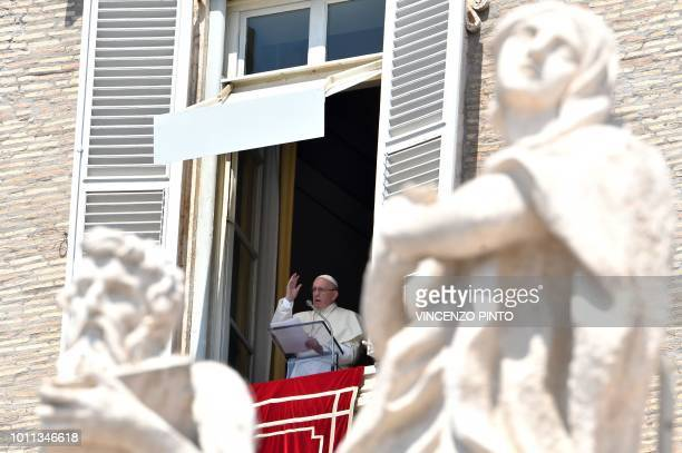 Pope Francis blesses pilgrims gathered in St Peter's Square at the Vatican during his Sunday Angelus prayer on August 5 2018
