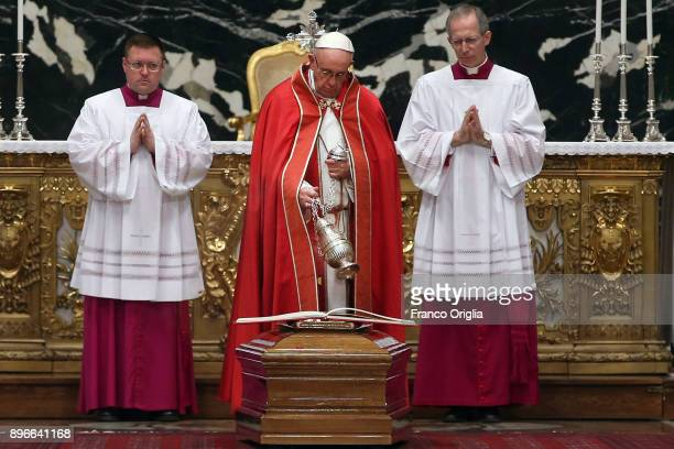 Pope Francis blesses the coffin of former Archbishop of Boston US Cardinal Bernard Law at the St Peter's Basilica on December 21 2017 in Vatican City...