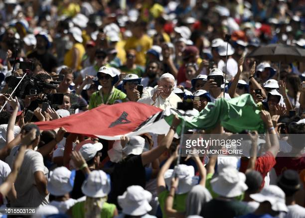 Pope Francis blesses the faithfuls after a mass to the italian youths at St Peter's square in the Vatican on August 122018